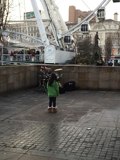 Girl watching drummer in Manchester uk photo