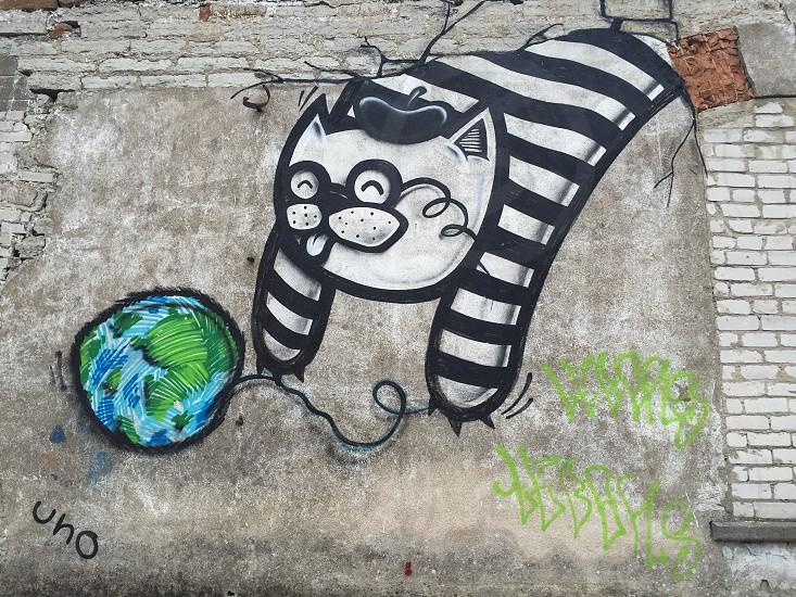 Outdoor day horizontal colour graffiti street art cat French stripes beret world globe yarn wall Tallinn Estonia Europe European travel photo
