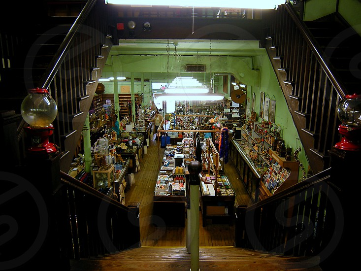 Inside of large old fashioned general department store on staircase photo