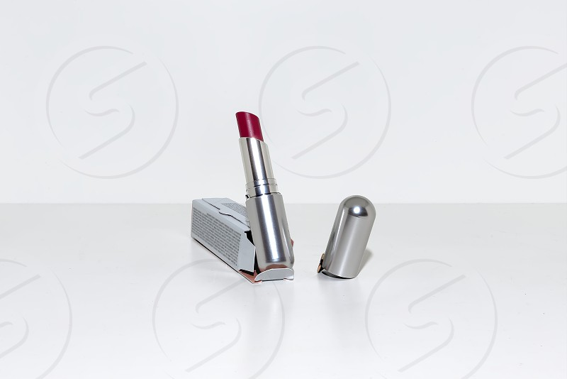 View of close up of open lipstick red color on a white background photo