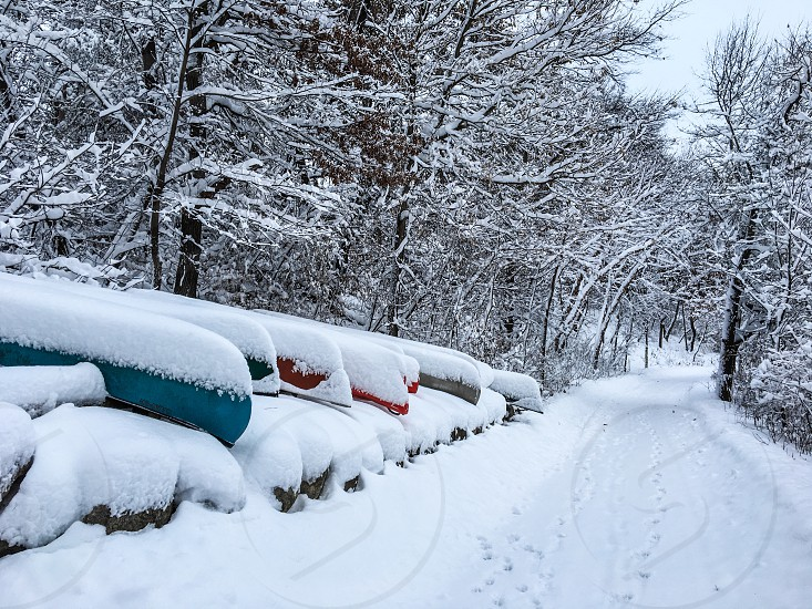 Memories of Summer. Canoes covered in snow. photo