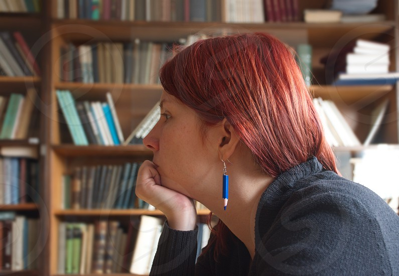Young woman sitting in the library photo