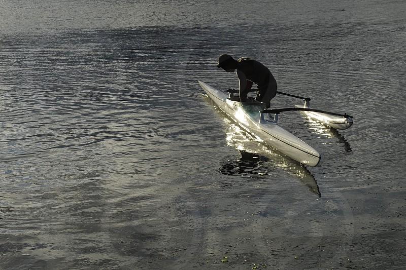 man in grey boat in water photo