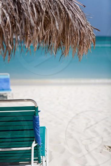Caribbean beach beach chair white sand. photo