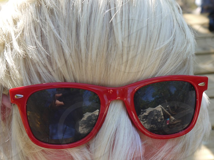 red sunglasses upon white hair (teenager) photo