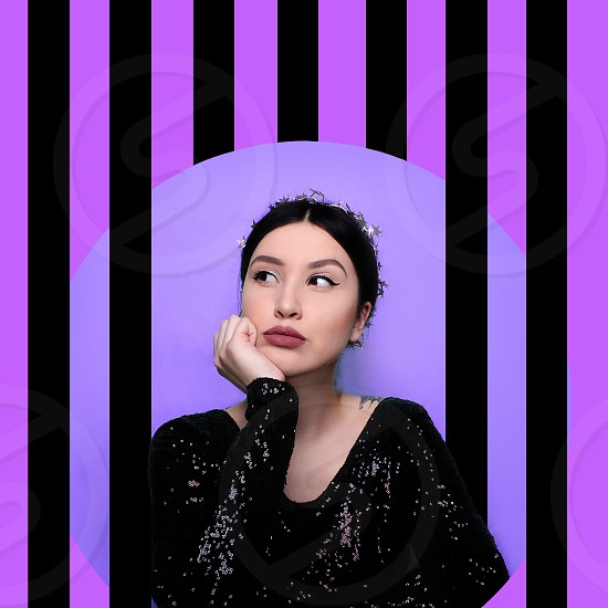 Art portrait of funny woman in black glitter dress in purple backraund with black lines photo