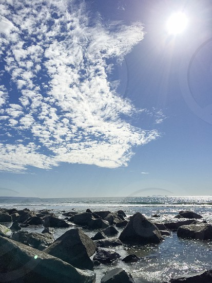 Beach rocks ocean clouds sun coast California Coronado island photo