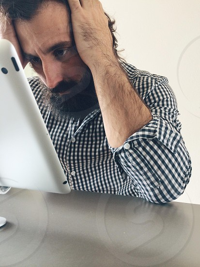 Frustrated checking email on iPad photo
