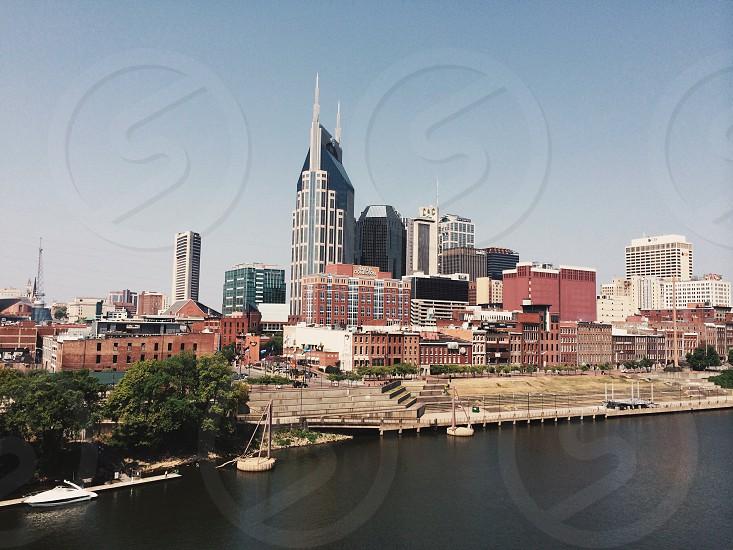 city buildings across lake photo