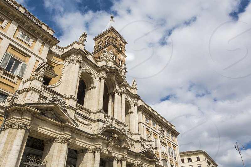 "Facade of the Santa Maria Maggiore Basil in Rome. The Basilica di Santa Maria Maggiore ('Basilica of Saint Mary Major') or church of Santa Maria Maggiore is a Papal major basilica and the largest Catholic Marian church in Rome Italy from which size it receives the appellation ""major"".  photo"