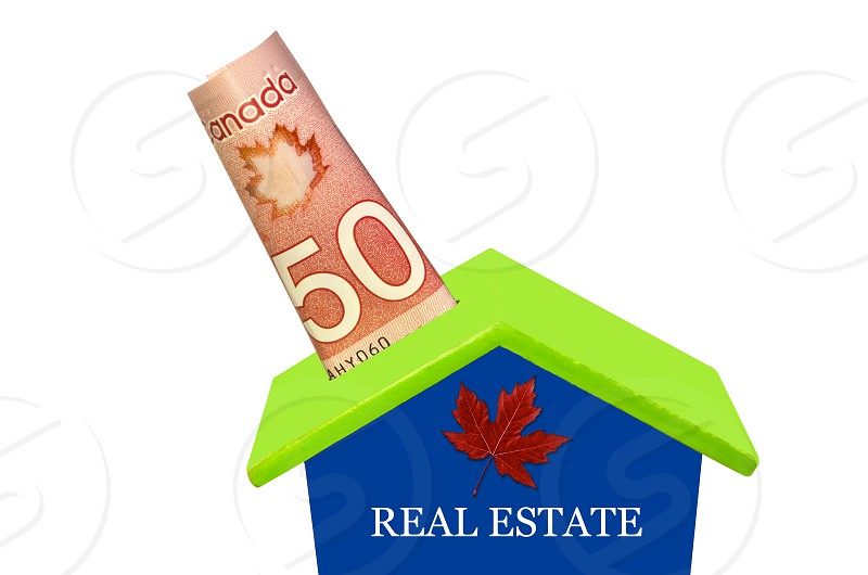 Canadian Fifty Dolars In MoneyboxReal Estate Saving Money Concept photo