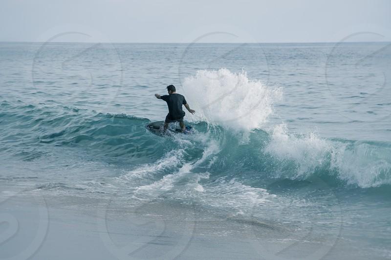 Freedom Vacations Summertime Beach Surfer Sea Splash photo
