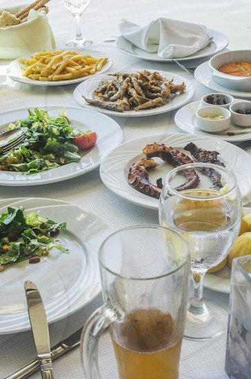 Table in greek restaurant. Salat and fish. Greece Athens Piraeus photo
