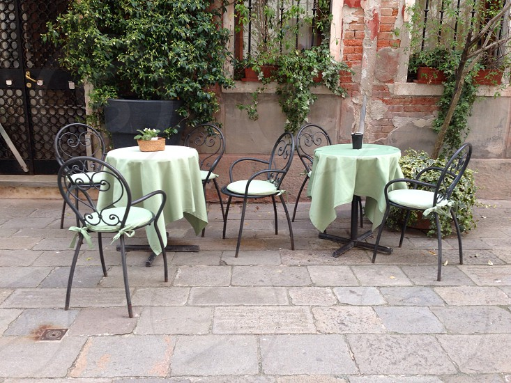 Green linen tablecloth street cafe restaurant dining chairs tables photo