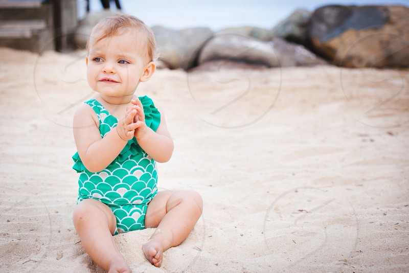 Baby Playing outside on the beach  photo