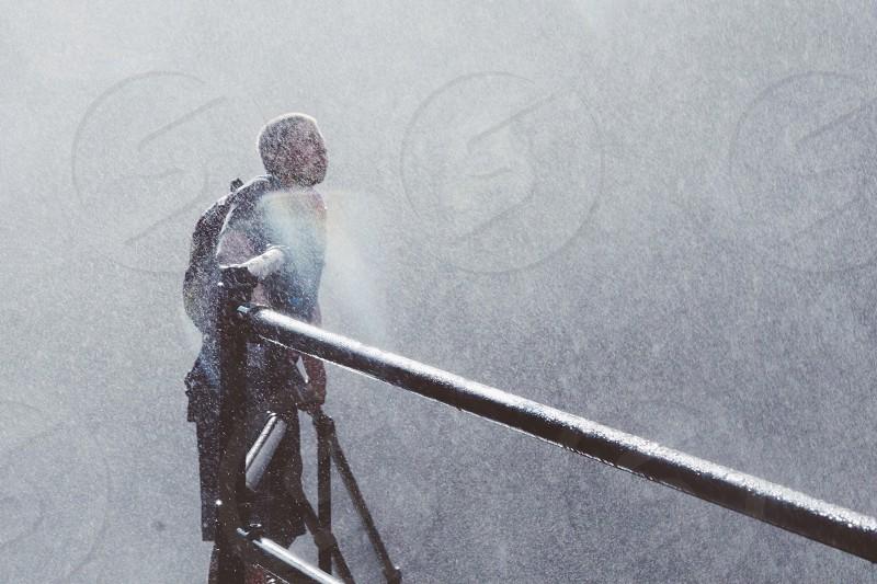 man in rain photo