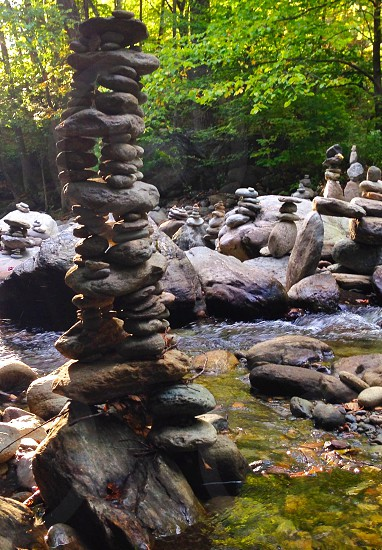 Cairns rocks stream river clear pure fresh natural signpost photo