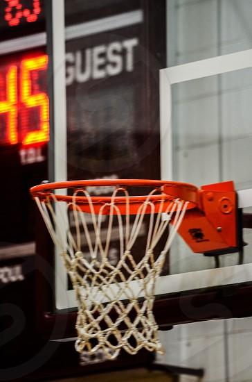 A basketball hoop and scoreboard. photo