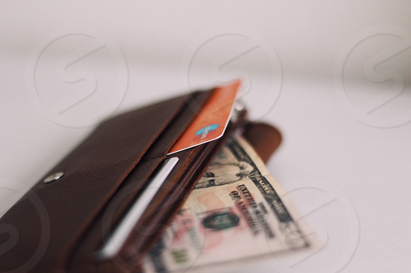 50  u.s dollar bill in brown leather wallet in macro photography photo