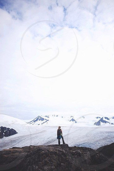 woman standing on rocky mountain photo