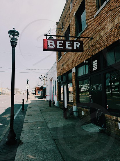 beer sign on building photo
