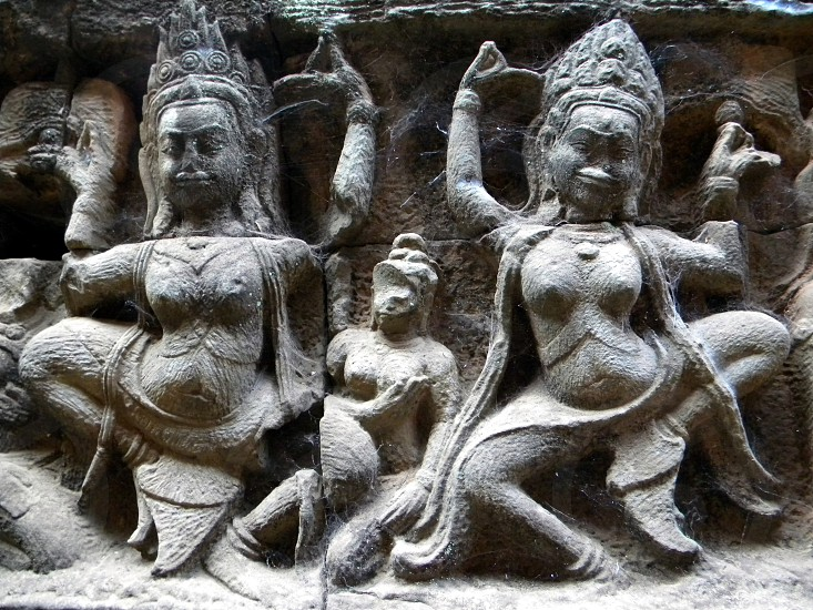 Siem Reap Cambodia stone carving ruins spider webs cob webs archeology photo