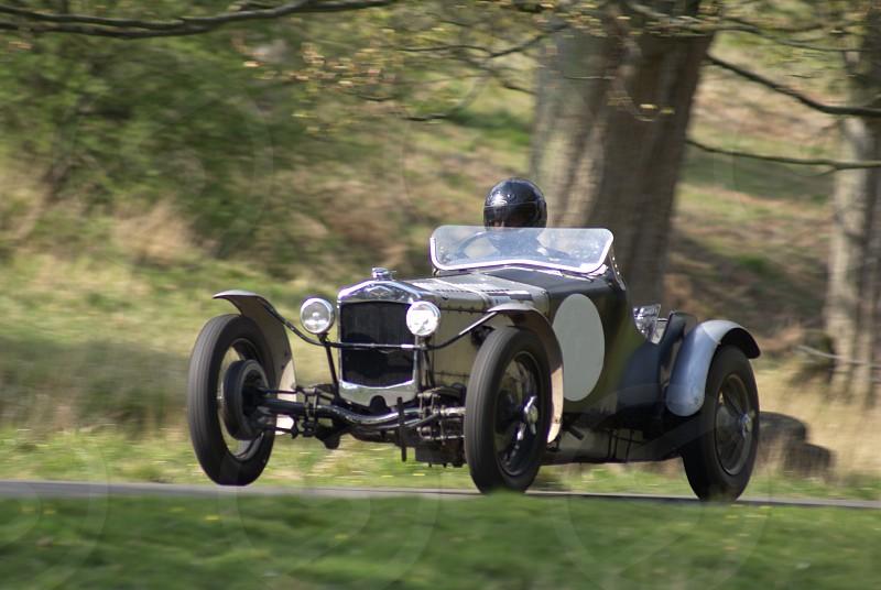 green and brown vintage racing car photo