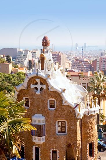 Barcelona park Guell fairy tale mosaic house on entrance photo