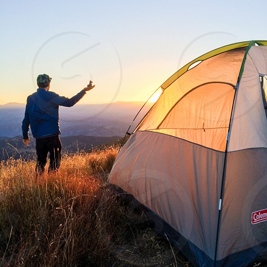 sunrise toy camping tent man mountains photo