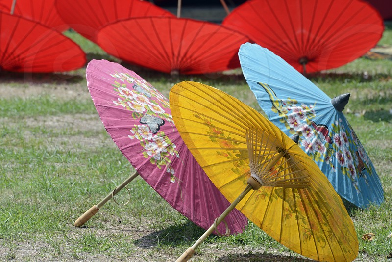 a umbrella production in the city of chiang mai in the north of Thailand in Southeastasia.  photo