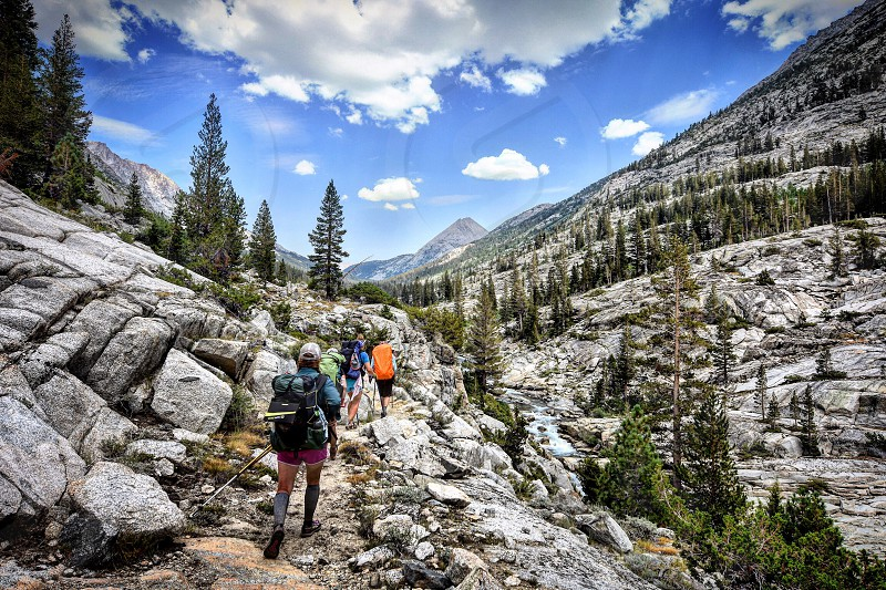 Backpackers hiking in the mountains photo