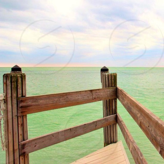 A dock facing the wide open ocean  photo