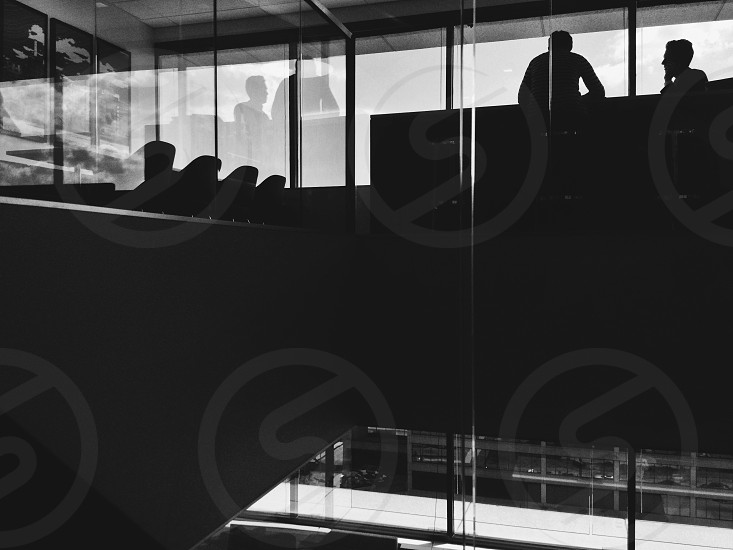 silhouettes of people in building photo