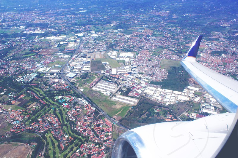 view of the city on top by the airplane photo