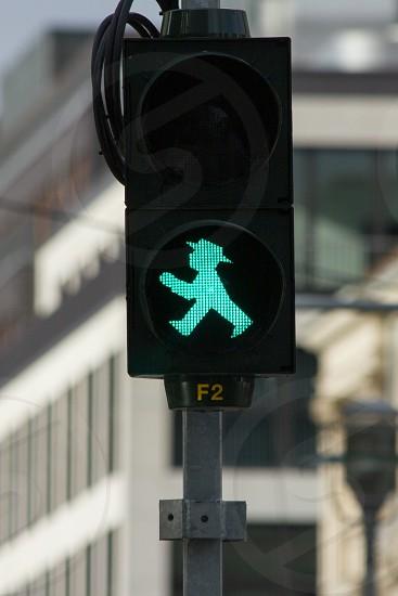 Green figure in a pedestrian 'walk' light. photo