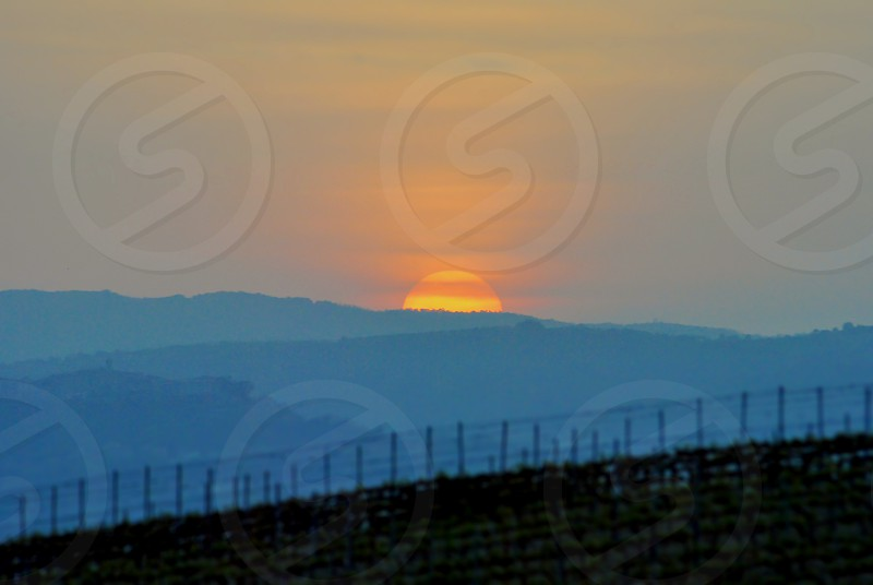 sunset over italian countryside photo
