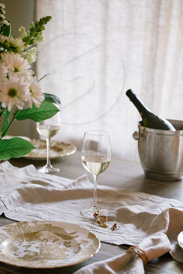 Sparkling wine in a cozy home setting. Upscale home decor wine welcoming natural light. photo