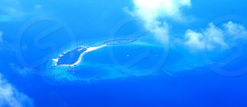 bird's eye view island in the middle of large body of water photo