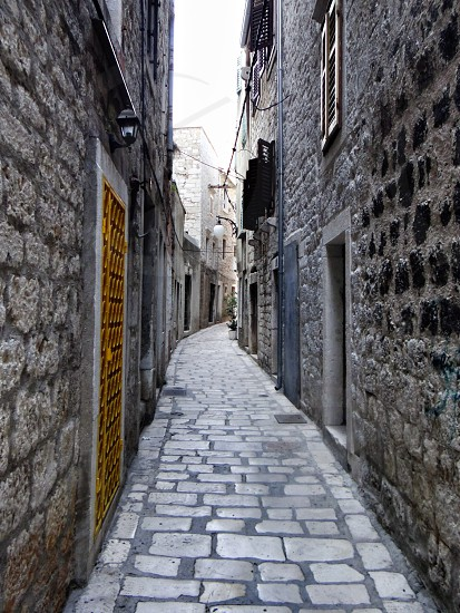 view of venice street with gray stone floor and walls photo
