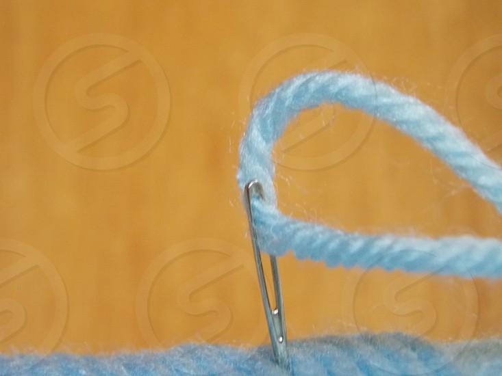 Blue Yarn Through Silver Needle photo