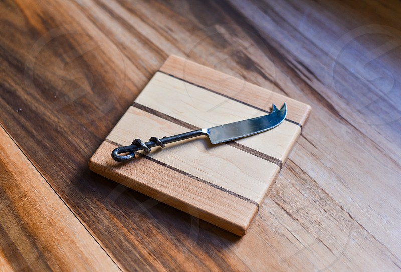 knife cheese cheeseboard wood grain kitchen appetizers photo