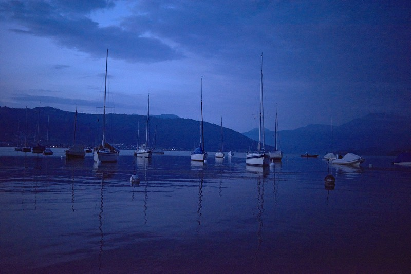 Quiet morning on the jetty with sailing boats in the port photo