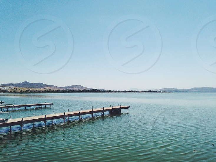 view of wooden port and blue ocean photo