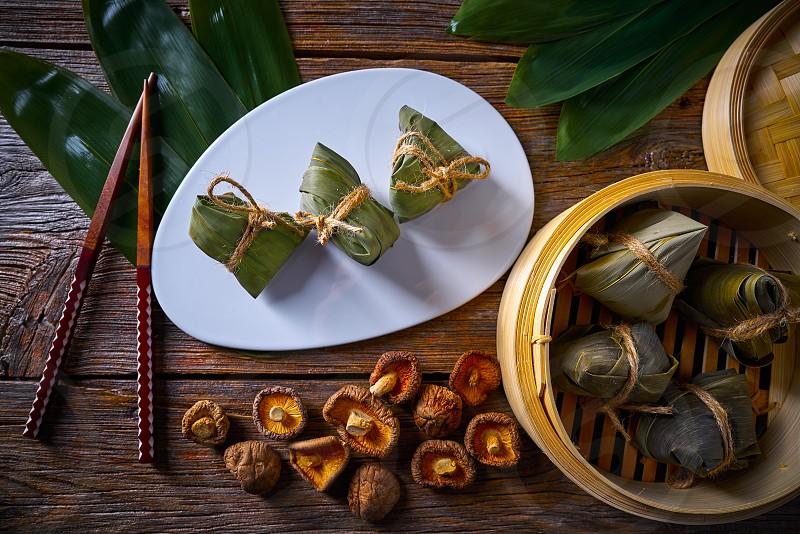Zongzi Glutinous sticky Rice Dumplings recipe wrap with bamboo leaves asian food photo