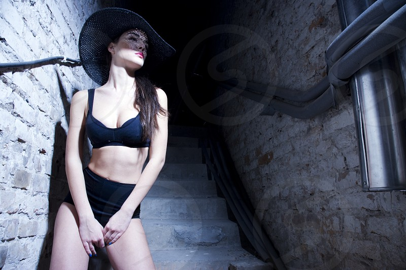 Woman posing in front of basement wall photo