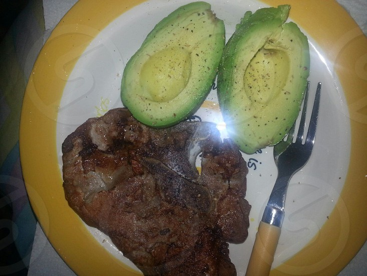 Low Carb Pork rib loin and fresh raw avocados photo