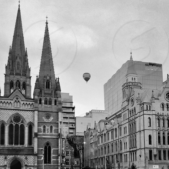 hot air balloo in the air above the city photo