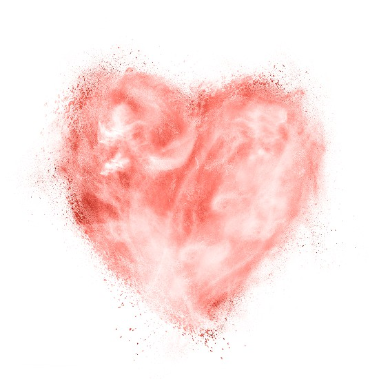 Cloudy heart from powder explosion in a color of the year 2019 Living Coral Pantoneon on a white background . Place for text. Concept St. Valentine's Day. photo