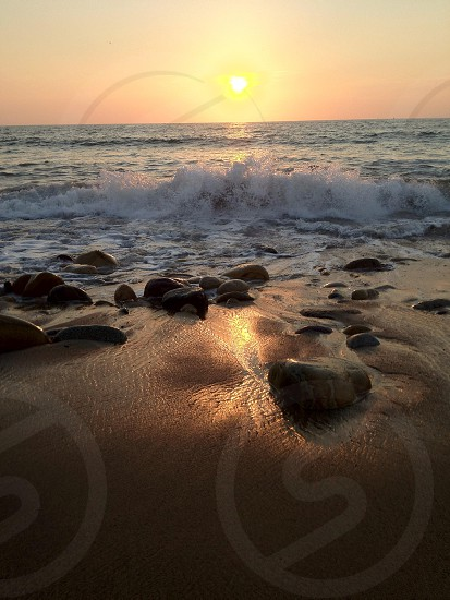 beach waves sunset photo photo