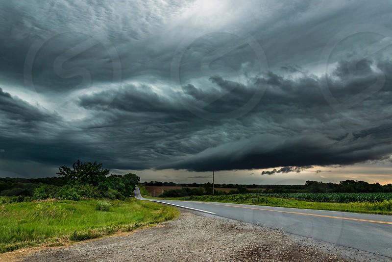 Kansas thunderstorm road Flint Hills adventure risk weather photo